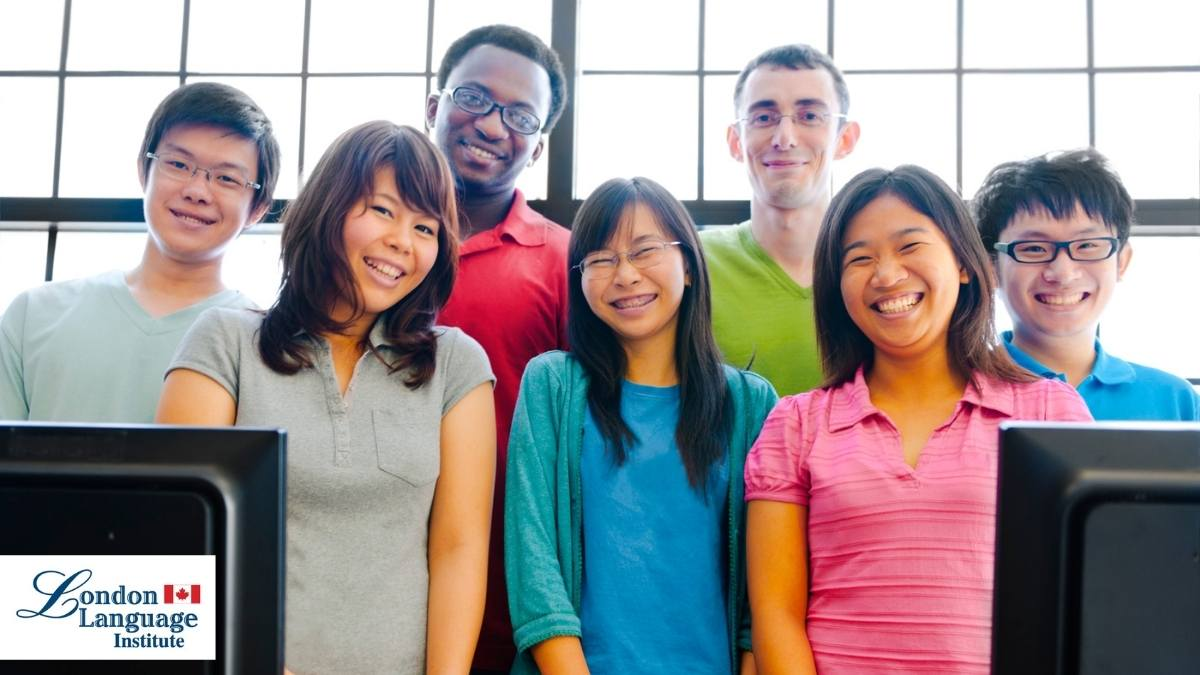 ESL class students smiling at camera