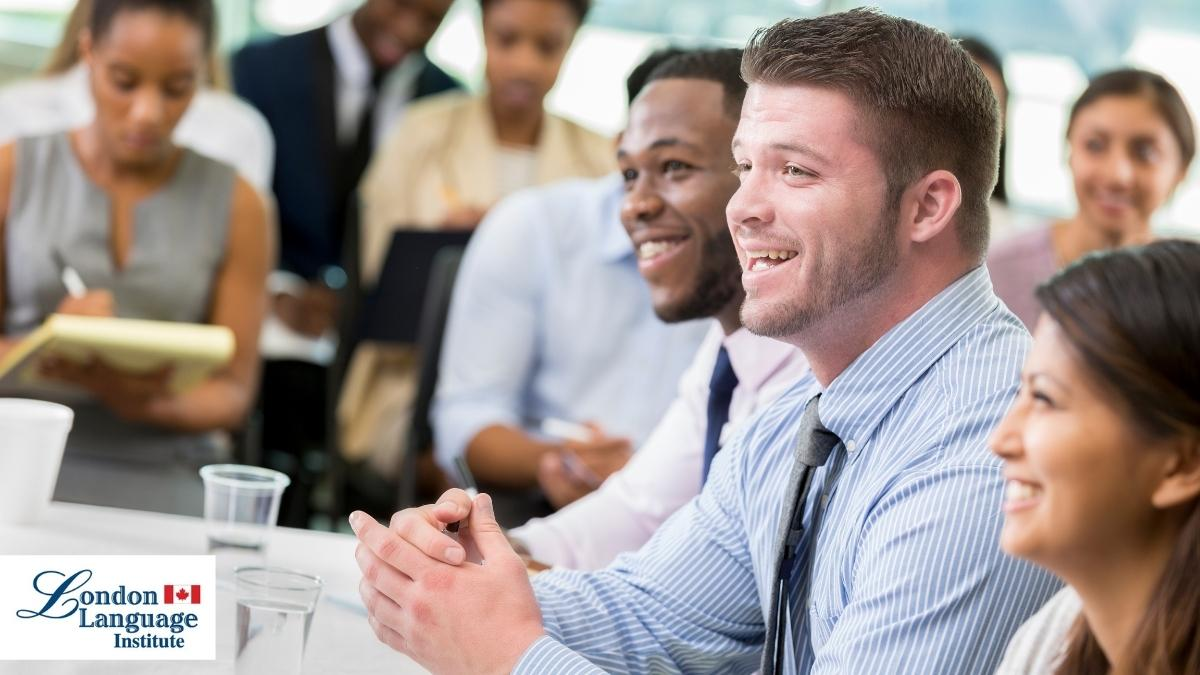 business school class with laughing student